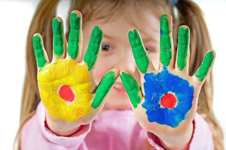 Young girl with hands painted Standard-Bild