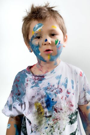 Young boy with hands painted
