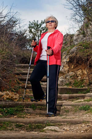 Senior woman train nordic walking photo