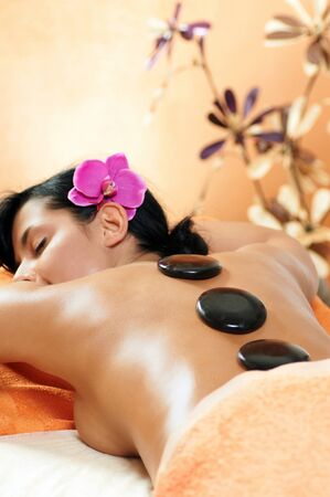 Woman getting a hot stone massage at spa salon Stock Photo - 10696729