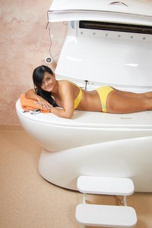 hydromassage: Young woman  in spa salon Stock Photo