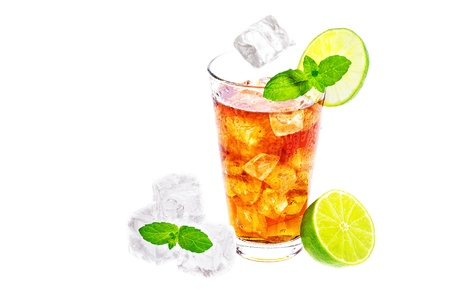 Cold glass of iced tea with ice cubes, fresh mint and lime isolated on white background