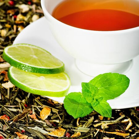 hot tea cup with lime and fresh mint photo