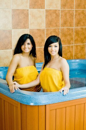 Two young women in the jacuzzi Stock Photo - 13061111