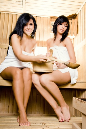 Two young woman relaxing in a sauna Stock Photo - 13061110