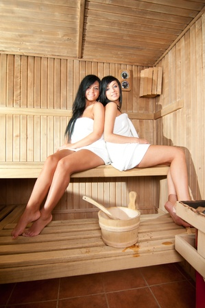 Two young woman relaxing in a sauna Stock Photo - 13061103
