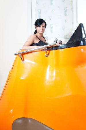 young woman training on slimming machine Stock Photo - 13060937