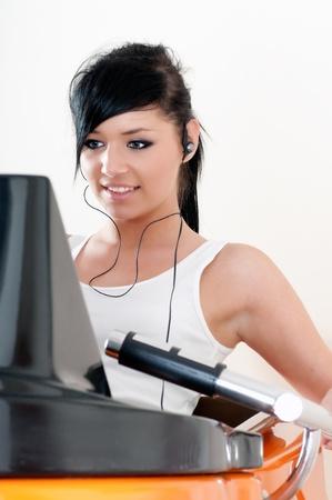 vibration machine: young woman training on slimming machine