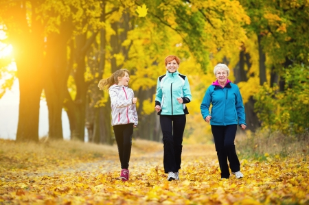 Three generations of women running in park
