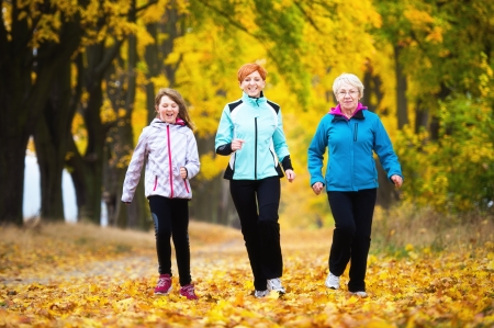Three generations of women running in park