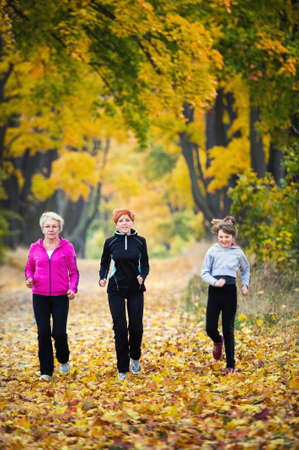 three generations of women: Three generations of women running in park