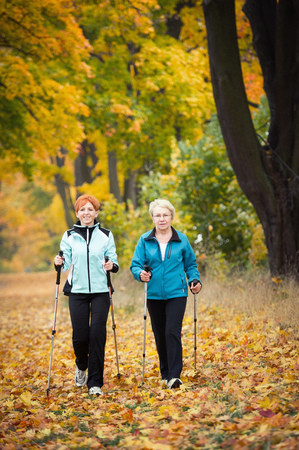active lifestyle: Mother and daughter train nordic walking Stock Photo