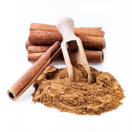 Cinnamon sticks and cinnamon powder on white