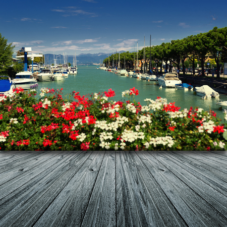 Peschiera on Garda Lake in Italy with wooden floor Stock Photo