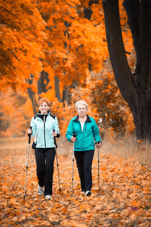 Mother and daughter train nordic walking Stock Photo