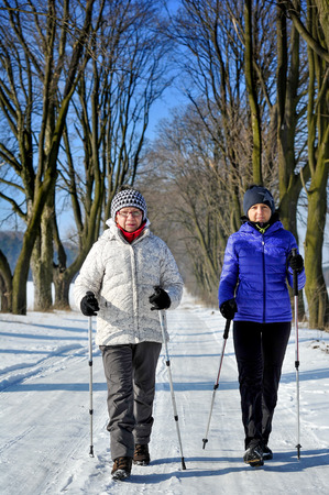 Mother and daughter train nordic walking photo
