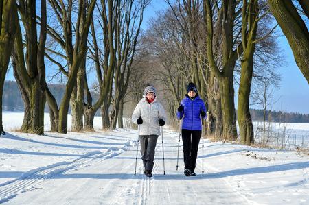 nordic walking: Mother and daughter train nordic walking Stock Photo