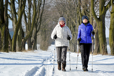 Mother and daughter train nordic walking 免版税图像