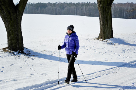 nordic walking: woman train nordic walking