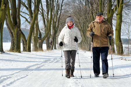 couple senior train nordic walking