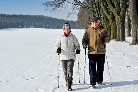 nordic walking: couple senior train nordic walking