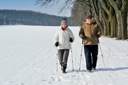 person walking: couple senior train nordic walking