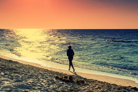 baltic sea: Woman runs In the Baltic Sea