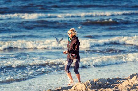 Woman runs In the Baltic Sea