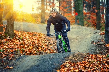 mountain biker: mountain biker riding in autumn forest Stock Photo