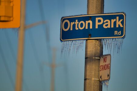 Icicles forming on frozen street sign after the 2013 ice storm in Toronto which result in a major power outage that lasted several days. Foto de archivo