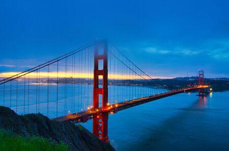 Sunrise over San Francisco behind the Golden Gate Bridge.