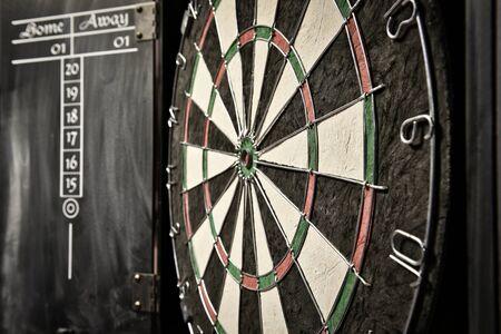 Dramatic photo of a dart board