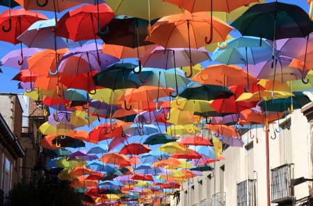 red umbrella: Street decorated with colored umbrellas Madrid,Getafe, Spain Stock Photo
