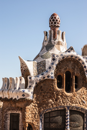 Barcelona park Guell fairy tale mosaic house on entrance Stock Photo