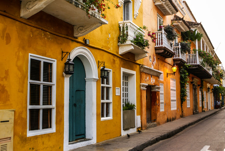 Typical street scene in Cartagena, Colombia of a street with old historic colonial houses photo