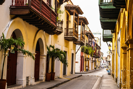 Typical street scene in Cartagena, Colombia of a street with old historic colonial houses Editorial