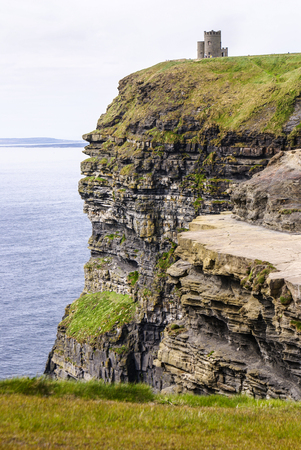 moher: Famous cliffs of Moher with tower. Ireland