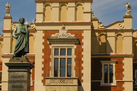 The statue of Adam Mickiewicz in front of the cloth hall in Krakow in Poland photo