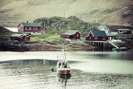 rorbu: Typical Norwegian fishing village with traditional red rorbu huts,Honningsvåg