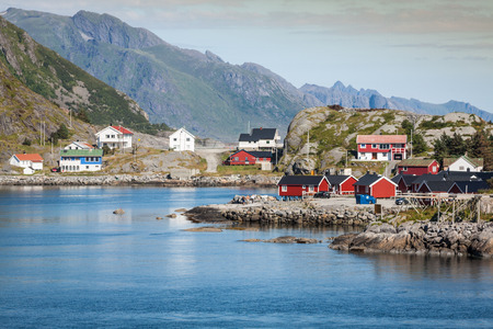 Picturesque fishing town of Reine by the fjord on Lofoten islands in Norway photo