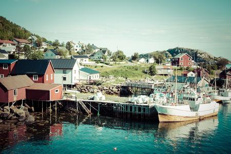 rorbu: Typical Norwegian fishing village with traditional red rorbu huts, Reine, Lofoten Islands, Norway Stock Photo