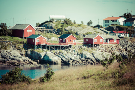 rorbu: Typical Norwegian fishing village with traditional red rorbu huts, Reine, Lofoten Islands, Norway Stock Photo