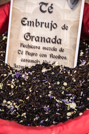 Spices, seeds and tea sold in a traditional market in Granada, Spain photo