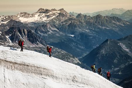 Mont Blanc, Chamonix, French Alps. France. - tourists climbing up the mountain Stock Photo - 29174173