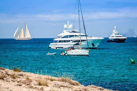 anchoring: Luxury yachts in turquoise beach of Formentera Illetes Stock Photo
