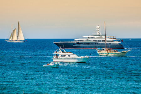Luxury yachts in turquoise beach of Formentera Illetes photo