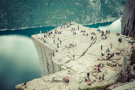 NORWAY - JUNE 2, 2012: unidentified group of tourists enjoy breathtaking views from Preikestolen rock