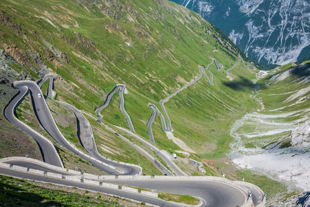 serpentine mountain road in Italian Alps, Stelvio pass, Passo dello Stelvio, Stelvio Natural Park photo