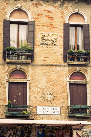 Facades of house on a street in Venice, Italy photo