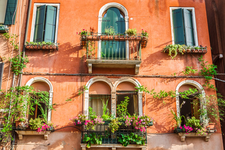 the merchant of venice: Buildings with traditional Venetian windows in Venice, Italy